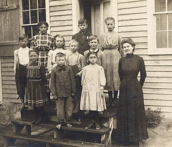 Kristin Holt   Education in the Old West. One Room Schoolhouse, photo of children and teacher on school steps.