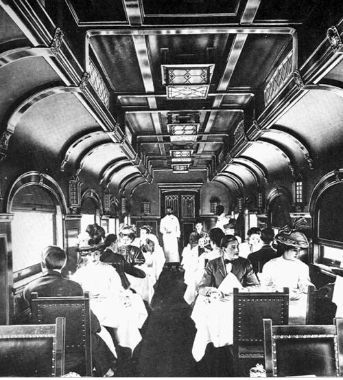 Pullman Dining Car. Passengers traveling in Sleeper Cars walked through the vestibule passageways from car to car to dine. Image: Public Domain