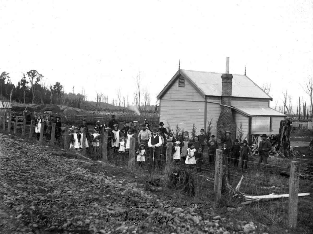 Group of children and adults outside Rata School on Arbor Day, 1 August 1894, Ohingaiti district (Rangitikei). Taken by Edward George Child. Alexander Turnbull Library ref. ID: 1/1-011003-G. [source]
