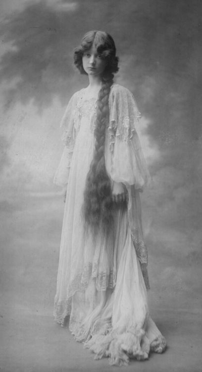 Victorian long hair braided and resting over shoulder. Cornelia Edith Yoï Crosse (1877-1944) - British Writer & Model. Photograph, circa 1900.