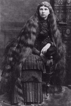 Image of Victorian woman sitting, displaying long hair. Longhairloom.com and Pinterest.