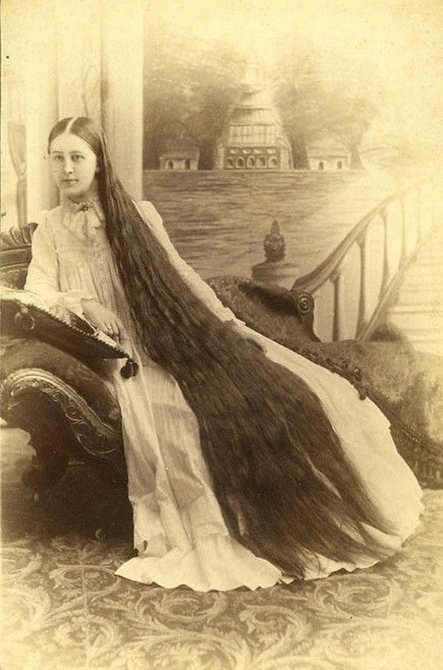 Victorian poses to display her long hair while wearing nightgown. Rapunzelsdelight.com and Pinterest.