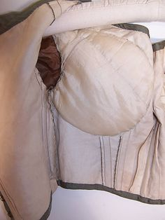 Victorian 1840s to 1850s ball gown hows large bust improver sewn into dress, from Pinterest