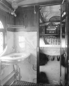 Bathroom in private rail car, circa 1890. On the right-hand side of the image, a doorway is open into the chamber beyond. Note the plumbed sink (and radiant heat water pipes below).