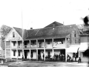 Historic Idaho Hotel. Built in 1863 in Ruby City, on Jordan Creek (a mile below Silver City). in 1866, two-yuear-old Silver City became the county seat and many homes and buildings were moved to Silver City. The Idaho Hotel was dismantled, laoded onto sleds and skids and pulled up the snow- and ice-covered road to a new location in Silver City. A three-story addition was added at the same time. [text source: Images of America: Owyhee County, by Robert L. Deen, p 29]