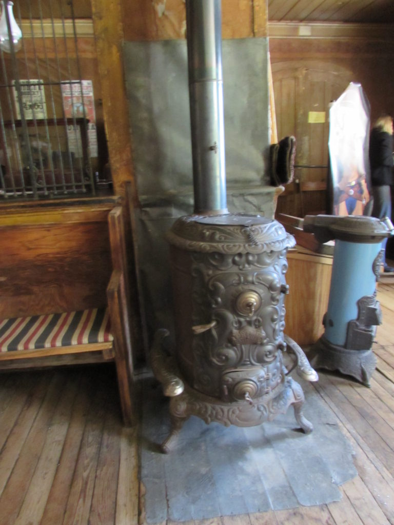 Stove (wood or coal?) in the lobby of historic Idaho Hotel, Silver City, Idaho. Image: taken 2016 by Kristin Holt.