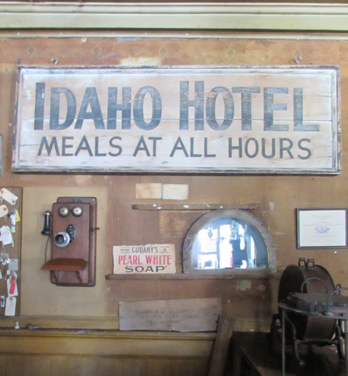 Historic check-in area of the historic Idaho Hotel. The half-circle window was a pass-through into the bar behind for the cashier to deliver money to the bartender. Ladies didn't enter the bar in those days.