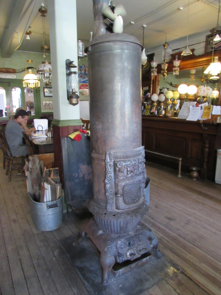 Wood-burning stove used to heat the bar/restaurant area behind the lobby of the historic Idaho Hotel.