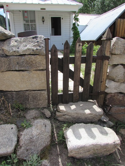 Stone steps and garden gate to an historic private residence in Silver City. Image: 2016, taken by Kristin Holt.