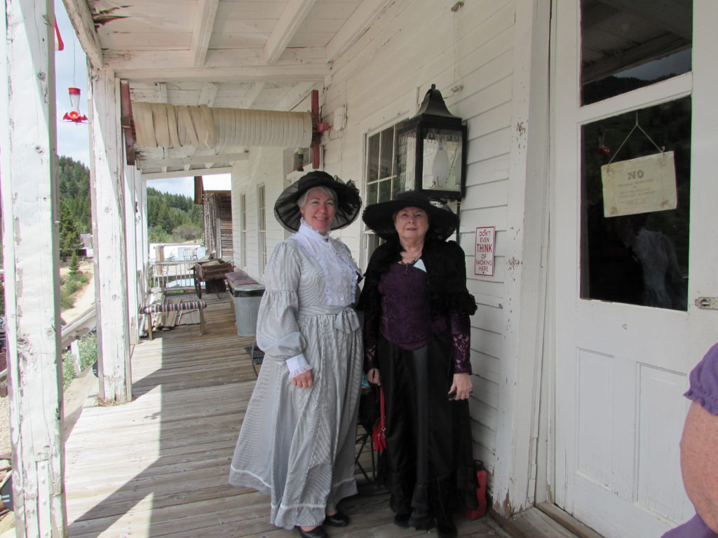 Kristin Holt (left) and Charlene Raddon (right) [we are both authors of western historical romance], dressed in Victorian-era clothing, on the porch of the Historic Idaho Hotel, Silver City, Idaho.
