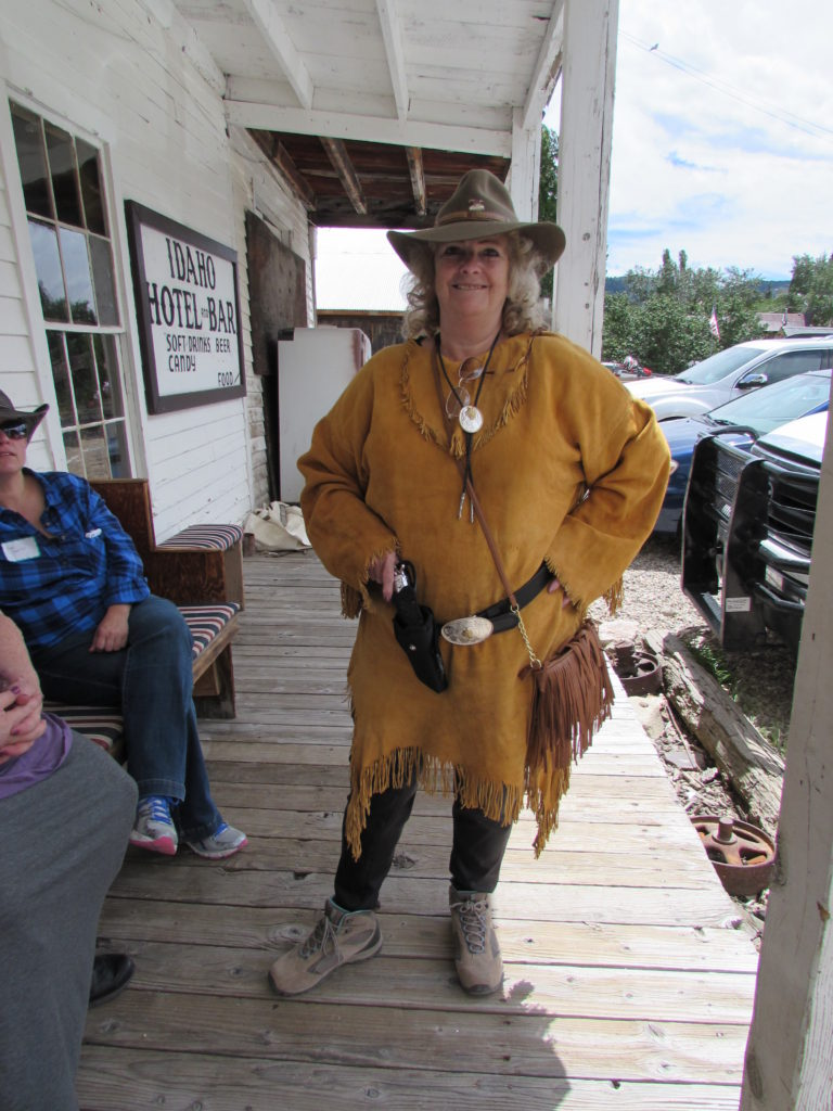 Shirl Deems, Reader, dressed in real buckskin like a Mountain Man's lady. On the porch of the historic Idaho Hotel, Silver City, Idaho.
