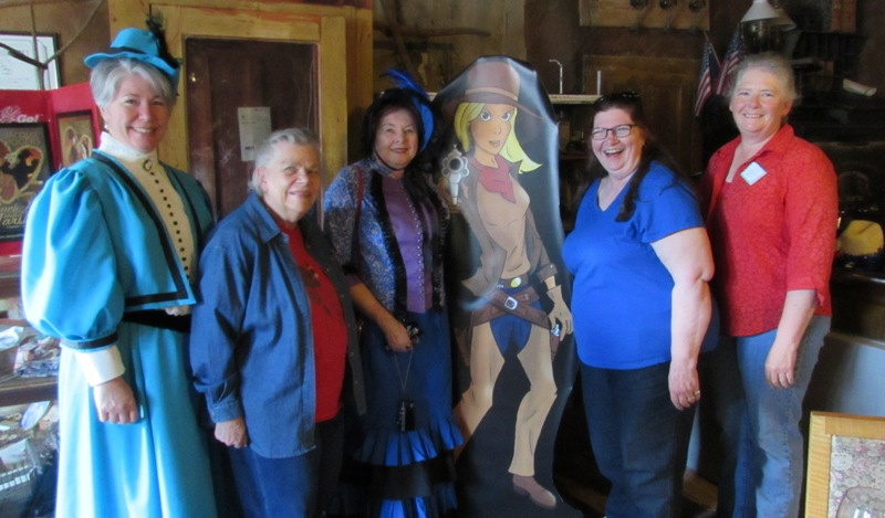 Authors: Kristin Holt, Judith Laik, Charlene Raddon, (Honey--Jacquie's character), Jacquie Rogers, and Paty Jager, together in the lobby of the historic Idaho Hotel.