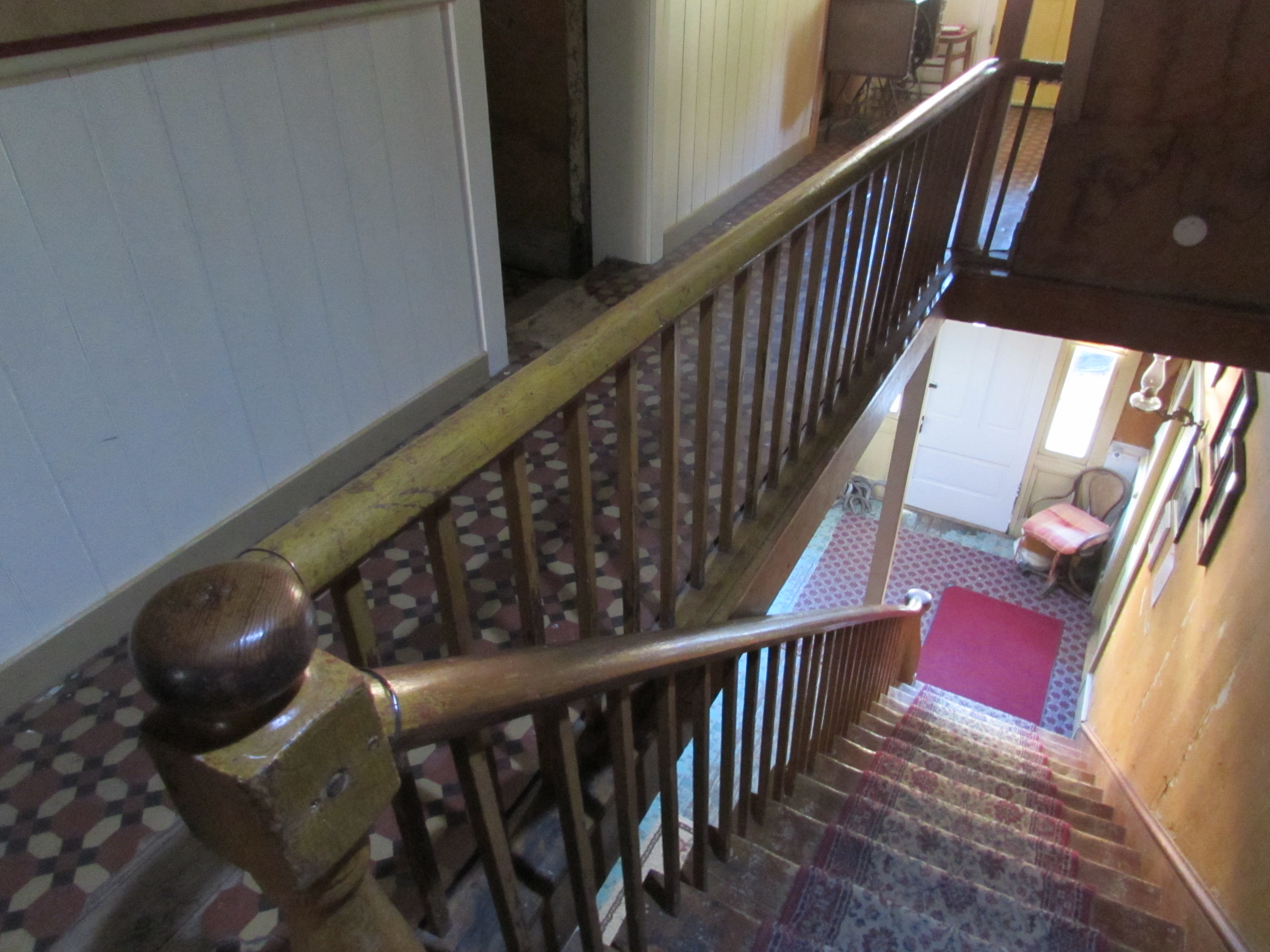 Historic Idaho Hotel staircase, as viewed from the second floor landing, outside guest rooms. Silver City, Idaho.