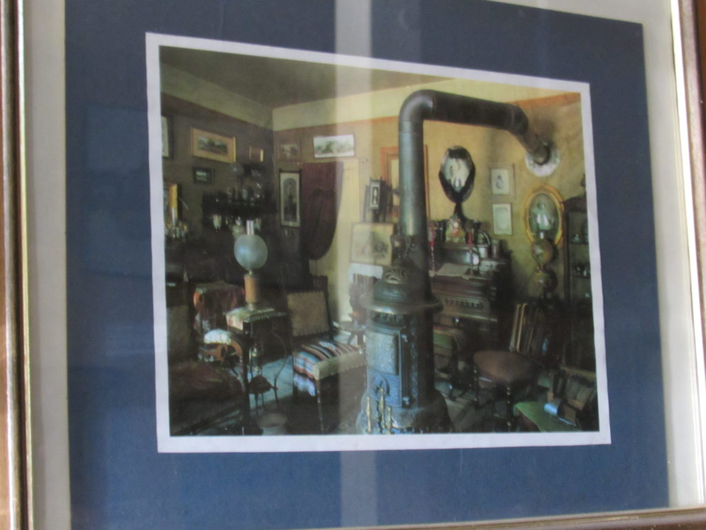 Framed picture of the contents and arrangement of the Ladies' Parlor, Historic Idaho Hotel, Silver City, Idaho.