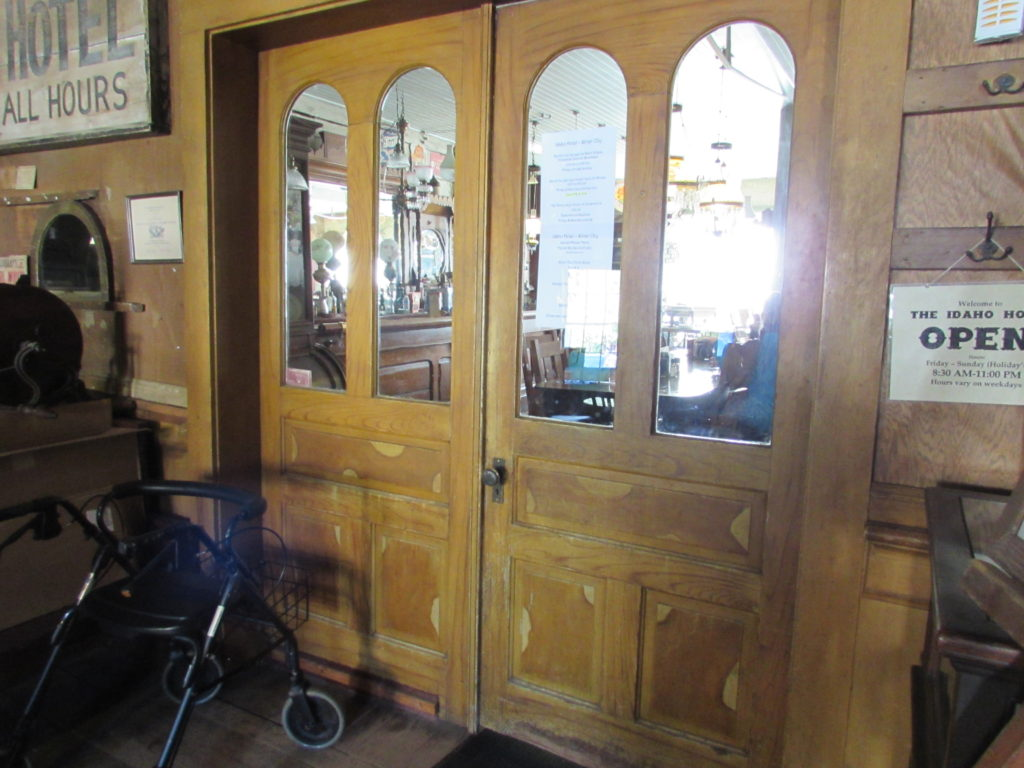 Vintage, antique double doors separating lobby from the dining room/bar. This natural-wood (rather than painted) side, as viewed from the lobby. Historic Idaho Hotel, Silver City, Idaho.