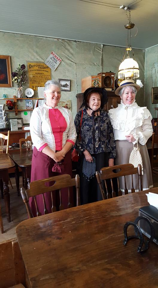 Authors: Paty Jager, Charlene Raddon, and Kristin Holt in Victorian-era costumes. In dining room/bar of historic Idaho Hotel in Silver City, Idaho. June 2016. Image taken by one of my friends there...I believe it may have been Shirl Deems.