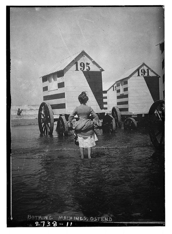 Kristin Holt | Victorians at the Seashore. Vintage photograph of Victorian Bathing Machines. Saved from mentalfloss to Pinterest.