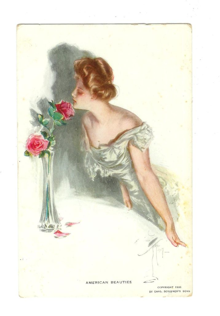 Kristin Holt | Vintage Postcard with artwork of turn-of-the-century woman in evening dress, inhaling the scen tof American Beauty Roses in a bud vase. Image courtesy of Jackie's Vintage Postcards.
