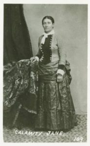Martha Jane Cannary (known as Calamity Jane) in stylish ladies' dress.