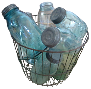 Kristin Holt   Old West Mason Jars. A vintage wire basket filled with blue mason jars with metal lids.