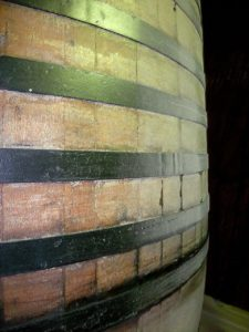 Kristin Holt | Victorian Americans Celebrated Oktoberfest. Photograph: an artistic up-colose view of a wooden cask and iron(?) bands.