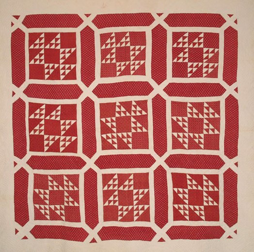 A spectacular circa 1825 quilt with various beautiful Turkey Red calicoes that date back to circa 1815. The sashing that makes up the garden maze pattern is all one calico, with different Turkey red calicoes paired with linen for the pieced blocks and borders. Individual Flying Geese blocks measure 5 x 5 inches and are arranged in a variation of the Old Maid's Puzzle and placed within a Garden Maze. A lovely seven inch linen outer border surrounds the inner design.