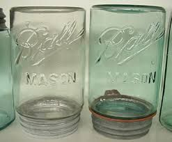 Kristin Holt   Old West Mason Jars. Photo of two Ball Masons, one clear and one blue. Ball Co. logo dates to 1900-1910.