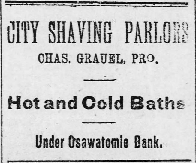 City Shaving Parlors offers both hot and cold baths. Advertised in the Osawatomie Graphic of Osawatomie, Kansas, on June 3, 1893.