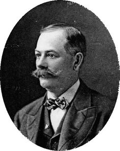 Kristin Holt   Victorian Era Men's Hairstyles. Vintage photograph of Sheridan Lockhart, 1900. Lockhart's hair is parted on the side, cut above the ears, and wears a full mustache.
