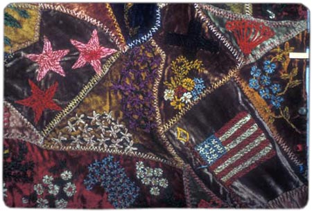 This crazy quilt from the late 19th century, by Clara Graf Lederer Stanton, features a profusion of embroidery in cotton and chenille thread. [Image: