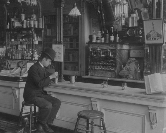 Kristin Holt | The Victorian-era Soda Fountain. Black and white vintage photograph: Soda Fountain inside Vogelsang's Drugstore, 1895, Chicago. Image Courtesy of Pinterest.