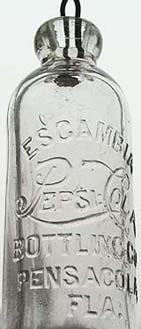 Kristin Holt | New at the Soda Fountain: Pepsi-Cola! Photograph of a clear glass Pepsi-Cola bottle with a vintage logo.
