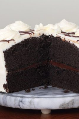 Kristin Holt | Victorian Baking: Devil's Food Cake ~ Image: Devil's Food Cake photographed, showing the cross-section of the iced two-layer cake.