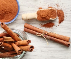 Kristin Holt | Cinnamon powder and stick, image copyright Freepik, used with premium subscription.