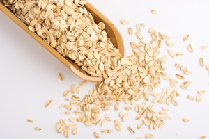 Kristin Holt | Dry rolled oats in wooden scoop, used with subscription from freepik.com