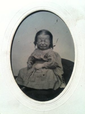 Kristin Holt | Victorian-American Headaches: Part 3. Vintage photograph (19th century) of a small child, crying.